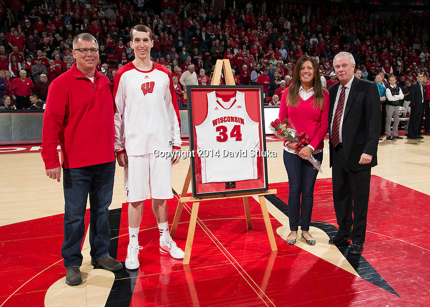 Wisconsin Badgers senior Zach Bohannon (34) with his parents and Head Coach Bo Ryan prior to an NCAA college basketball game against the Purdue Boilermakers Wednesday, March 5, 2014 in Madison, Wis. The Badger won 76-70. (Photo by David Stluka)