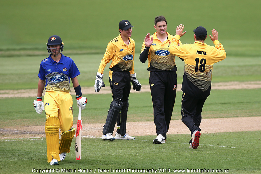 Hamish Bennett (centre) celebrates a wicket during the Wellington Firebirds v Otago Volts, Ford Trophy One Day match round five at Bert Sutcliffe Oval in Lincoln, New Zealand on Friday, 29 November 2019. Photo: Martin Hunter / lintottphoto.co.nz