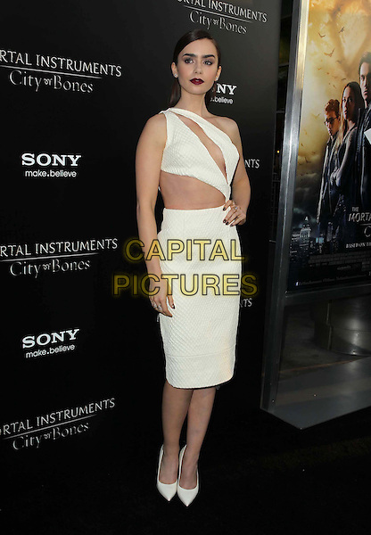 Lily Collins<br /> &quot;The Mortal Instruments: City Of Bones&quot; - Los Angeles Premiere Held At ArcLight Cinemas Cinerama Dome, Hollywood, California, USA.<br /> August 12th, 2013<br /> full length white dress one shoulder slash slashed cut out away midriff belly stomach hand on hip<br /> CAP/ADM/KB<br /> &copy;Kevan Brooks/AdMedia/Capital Pictures