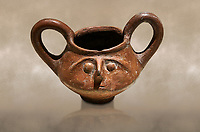 Hittite terra cotta double handled jug with a relief human face- 17th - 16th century BC - Hattusa ( Bogazkoy ) - Museum of Anatolian Civilisations, Ankara, Turkey