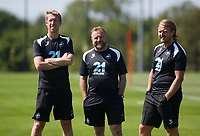 (L-R) manager Graham Potter, Bjorn Hamberg, assistant coach and Billy Reid, assistant manager watch the players train on the pitch during the Swansea City Training Session at The Fairwood Training Ground, Wales, UK. Tuesday 03 July 2018
