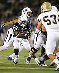 Nevada's James Butler (20) takes the handoff from quarterback Tyler Stewart (15), rear, during the first half of an NCAA college football game against UC Davis in Reno, Nev. on Thursday, Sept. 3, 2015. UC Davis defender Russell Reeder (53) was in on the play. (AP/Cathleen Allison)