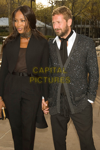 "NAOMI CAMPBELL & STEFANO PILATI.Opening Night of ""La Fille du Regiment"" at The Metropolitan Opera, Lincoln Center, New York, NY, USA..April 21st, 2008.half 3/4 length holding hands brown top grey gray cardigan scarf beard facial hair gold choker necklace .CAP/LNC/TOM.©TOM/LNC/Capital Pictures."