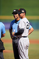 Scottsdale Scorpions coach Carlos Mendoza (28), of the New York Yankees organization, during the lineup exchange before a game against the Mesa Solar Sox on October 21, 2016 at Sloan Park in Mesa, Arizona.  Mesa defeated Scottsdale 4-3.  (Mike Janes/Four Seam Images)