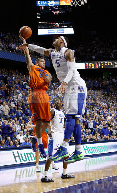 UK's Willie Cauley-Stein does his best to block Florida's Scottie Wilbekin's shot. in Lexington, Ky., on Sunday, March, 10, 2013. Photo by James Holt | Staff