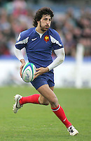 French full back Mathieu Belie on the attack during the Division A U19 World Championship clash at Ravenhill.