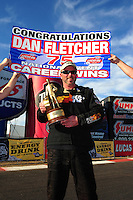 Feb. 19, 2012; Chandler, AZ, USA; NHRA super comp driver Dan Fletcher celebrates 75th national event win at the Arizona Nationals at Firebird International Raceway. Mandatory Credit: Mark J. Rebilas-
