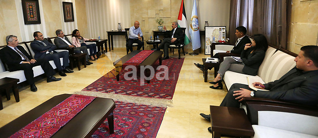 """Palestinian Prime Minister Mohammad Ishtayeh Meets with a delegation of """"karama"""" campaign and praises their efforts, in the West Bank city of Ramallah, on September 18, 2019. Photo by Prime Minister Office"""