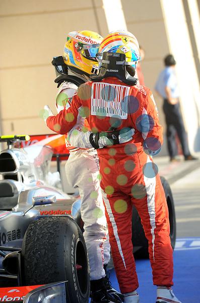 F1 GP Bahrain, Manama 12. - 14. March 2010.Lewis Hamilton (GBR), McLaren F1 Team - Fernando Alonso (ESP),  Scuderia Ferrari ..Picture:Hasan Bratic/Universal News And Sport (Europe) 14 March 2010.