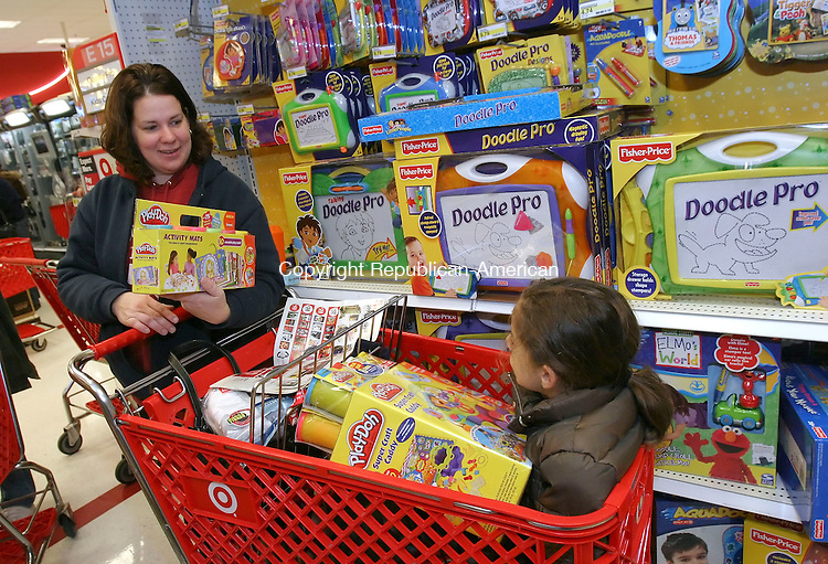 WATERBURY, CT 11/23/07- 112307BZ03- Denise Feliciano, of Waterbury, and her daughter Samantha Feliciano, 7, look through Play-Doh at the Target store in Waterbury on Black Friday. <br /> Jamison C. Bazinet Republican-American