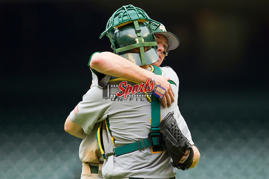 Relief pitcher Brooks Pinckard #16 of the Baylor Bears gets a hug from catcher Joey Hainsfurther #1 after closing out the win over the Houston Cougars at Minute Maid Park on March 4, 2011 in Houston, Texas.  Photo by Brian Westerholt / Four Seam Images