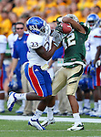 Kansas Jayhawks cornerback Dexter Linton (23) and Baylor Bears wide receiver Levi Norwood (42) fight for the ball during the game between the Kansas Jayhawks and the Baylor Bears at the Floyd Casey Stadium in Waco, Texas. Baylor leads Kansas 20 to 14 at halftime....