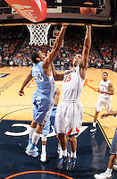 Virginia guard Malcolm Brogdon (15) shoots next to North Carolina forward James Michael McAdoo (43) during the second half of an NCAA basketball game Monday Jan. 20, 2014 in Charlottesville, VA. Virginia defeated North Carolina 76-61. (Photo/Andrew Shurtleff)