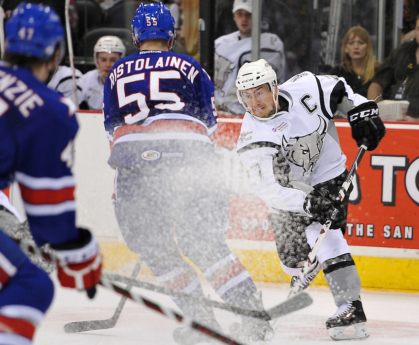 San Antonio Rampage captain Greg Rallo, right, passes the puck around Rochester Americans defenseman Rasmus Ristolainen (55) in the second period of an AHL hockey game, Saturday, Jan. 18, 2014, in San Antonio (Darren Abate/AHL)