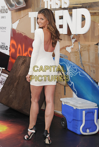 Charisma Carpenter<br /> arriving at the Los Angeles Premiere of &quot;This Is The End&quot; at Regency Village Theatre in Westwood, California on June 3rd 2013. <br /> full length white long sleeve dress black sandals open toe back rear behind looking over shoulder <br /> CAP/ROT/TM<br /> &copy;Tony Michaels/Roth Stock/Capital Pictures