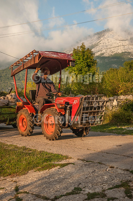 Old man on a tractor near Orjen Mountain, Montenegro
