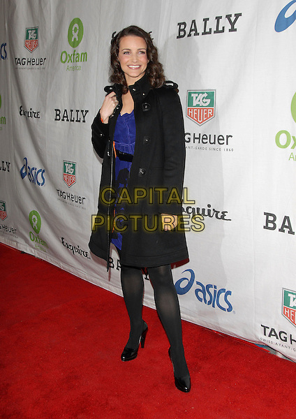 KRISTIN DAVIS.At The Annual OXFAM Fundraiser held at .The Esquire House  360° in Beverly Hills, .California, USA, November 29th 2006..full length black coat bag shoes tights purple dress.CAP/DVS.©Debbie VanStory/Capital Pictures