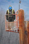 A worker waits from a lift while assisting the construction of a cofferdam at the Duboistown Bridge.