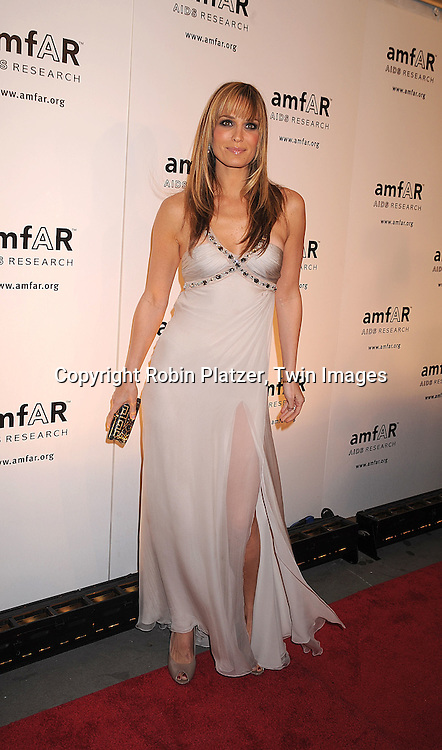 Molly Sims in Versace dress.posing for photographers at The amFAR New York Gala honoring Julian Schnabel, Carine Roitfeld and Bobby Shriver on January 31, 2008 at Cipriani 42nd Street. ..Robin Platzer, Twin Images..212-935-0770