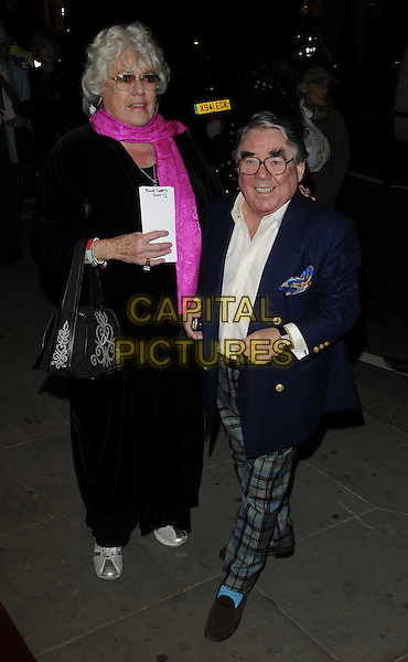ANNE HART & RONNIE CORBETT .Attends the 'Burke and Hare' World Premiere at The Chelsea Cinema, Kings Road, Chelsea, London, England, UK, 25th October 2010..full length pink scarf black coat bag navy blue blazer green tartan trousers plaid white shirt hand slippers brown socks tall short funny glasses .CAP/CAN.©Can Nguyen/Capital Pictures.