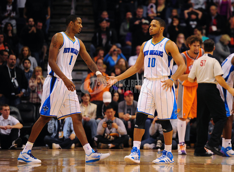 Dec. 26, 2011; Phoenix, AZ, USA; New Orleans Hornets guard Eric Gordon (10) celebrates with teammate Trevor Ariza (1) during game against the Phoenix Suns at the US Airways Center. The Hornets defeated the Suns 85-84. Mandatory Credit: Mark J. Rebilas-USA TODAY Sports