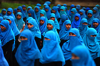 Bangladeshi girls attend a general assembly of Madrasa (Islamic education school) at Teknaf, on the outskirts of Dhaka, Bangladesh.