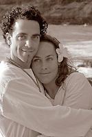 A young local couple at Ke'iki Beach, North Shore