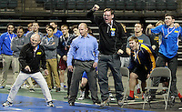 Northeastern Oklahoma A&M's coaches and teammates react after Blake Andrews decisioned Dalonte Holland of Ellsworth in the semifinals of the 285-pound matchup. (Photo by Michelle Bishop)