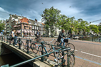 Bikers riding over the bridge in Amsterdam