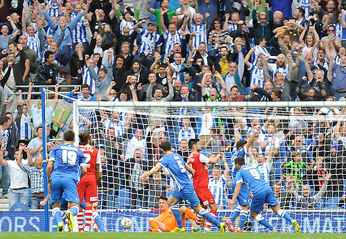 30.08.2014.  Brighton, England. Sky Bet Championship. Brighton and Hove Albion versus Charlton Athletic. Brighton's Lewis Dunk scores one of his two goals for Brighton in the 90th minute