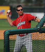 Manager Mickey Morandini (12) of the Lakewood BlueClaws throws batting practice prior to a game against the Greenville Drive on the Drive's Opening Day, April 5, 2012, at Fluor Field at the West End in Greenville, South Carolina. (Tom Priddy/Four Seam Images)
