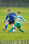 Concentration. Killarney Athletic's Paudie Clifford Killarney has no intention of buying this body swerve fromKillarney Celtic's Danny Healy in their U/11 Premier clash at Woodlawn on Saturday..   Copyright Kerry's Eye 2008