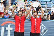 Washington, DC - August 9, 2015:   Bob Bryan (USA) (right) and Mike Bryan  (USA) (left) pose with their trophies during the Citi Open men's doubles final at Rock Creek Park Tennis Center in Washington, DC  August 9, 2015.  (Photo by Elliott Brown/Media Images International)