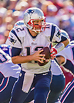 12 October 2014: New England Patriots quarterback Tom Brady prepares to make a hand-off during a game against the Buffalo Bills at Ralph Wilson Stadium in Orchard Park, NY. The Patriots defeated the Bills 37-22 to move into first place in the AFC Eastern Division. Mandatory Credit: Ed Wolfstein Photo *** RAW (NEF) Image File Available ***