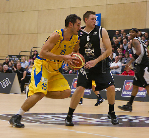 24.09.2010 British Basketball League Newcastle Eagles v Sheffield Sharks..Michael Tuck (15) Sharks Forward keeps the ball and out manouevres Eagles Guard Andrew Bridge (6).