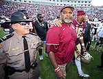 Florida State interim head coach Odell Haggins walks off the field with linebacker Jacob Pugh after an NCAA college football game against Louisiana Monroe in Tallahassee, Fla., Saturday, Dec. 2, 2017. Florida State defeated Louisiana Monroe.  (AP Photo/Mark Wallheiser)