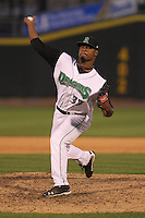 Dayton Dragons pitcher El'Hajj Muhammad #33 delivers a pitch during a game against the Lake County Captains at Fifth Third Field on June 25, 2012 in Dayton, Ohio. Lake County defeated Dayton 8-3. (Brace Hemmelgarn/Four Seam Images)