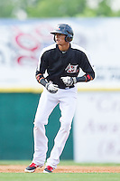 Jairo Beras (32) of the Hickory Crawdads takes his lead off of second base against the Charleston RiverDogs at L.P. Frans Stadium on May 25, 2014 in Hickory, North Carolina.  The RiverDogs defeated the Crawdads 17-10.  (Brian Westerholt/Four Seam Images)