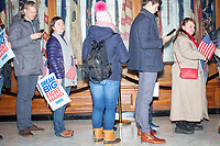 People wait in line to get a selfie with Democratic presidential candidate and Massachusetts senator Elizabeth Warren after she filed paperwork to get on the primary ballot at the NH State House in Concord, New Hampshire, on Wed., November 13, 2019.