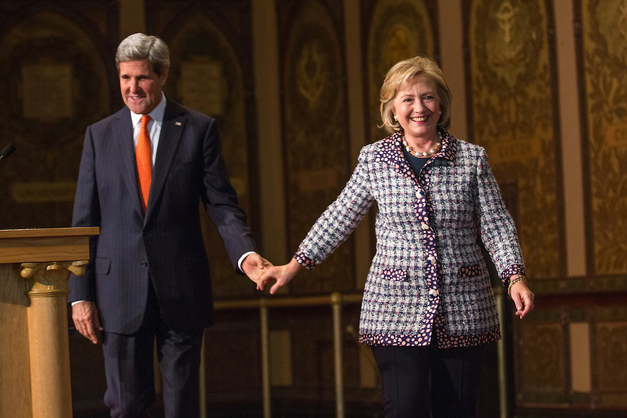 U.S. Secretary of State John Kerry and former U.S. Secretary of State Hillary Clinton participate in a symposium on advancing the progress and freedoms of Afghan women at Georgetown University in Washington.