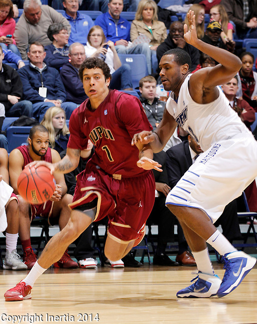 SIOUX FALLS, SD - MARCH 8:  Khufu Najee #1 from IUPUI drives against Luis Jacobo #13 from IPFW in the second half of their semifinal game Saturday afternoon at the 2014 Summit League Basketball Tournament in Sioux Falls, SD. (Photo by Dave Eggen/Inertia)