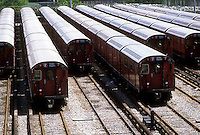 "Number 7 Flushing Line trains consisting of ""Redbird"" cars are laid up in the Flushing Yard in New York in the borough of Queens in 1980. The ""Redbirds"" were decommissioned in 2003 and after being stripped of recyclable and hazardous materials were sold as artifical reef material. (© Richard B. Levine)"