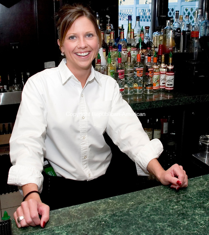 WATERBURY, CT -  30 SEPT 2005 -  093005JT02-- <br /> Amy Martin bartends at the Hills Restaurant at the Western Hills Gold Course.<br /> Josalee Thrift / Republican-American