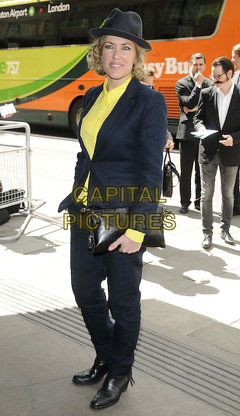 Cerys Matthews.The Ivor Novello Awards 2013, Grosvenor House Hotel, Park Lane, London, England..May 16th, 2013.full length black suit hat yellow shirt  clutch bag.CAP/CAN.©Can Nguyen/Capital Pictures.