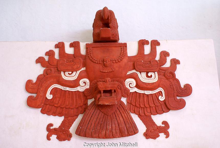 Replica of a red stucco macaw sculpture from Ballcourt I at the Mayan ruins of Copan, Copan Sculpture Museum  Honduras.