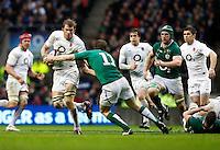 Photo: Richard Lane/Richard Lane Photography. England v Ireland. 17/03/2012. England's Tom Croft is tackle by Ireland's Andrew Trimble.