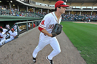 Center fielder Andrew Benintendi (2) runs onto the field for the first time with the Greenville Drive in a game against the Greensboro Grasshoppers on Tuesday, August 25, 2015, at Fluor Field at the West End in Greenville, South Carolina. Benintendi is a first-round pick of the Boston Red Sox in the 2015 First-Year Player Draft out of the University of Arkansas. Greensboro won, 3-2. (Tom Priddy/Four Seam Images)