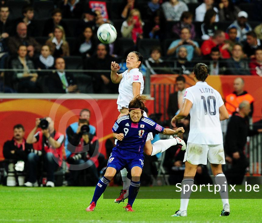 Fifa Women's World Cup Germany 2011 : Japan - USA  at Commerzbank Arena Frankfurt : Alex Krieger wint het kopduel van Nahomi Kawasumi.foto DAVID CATRY / Vrouwenteam.be