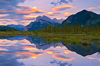 Clouds and Mt. Rundle and Sulphur Mountain reflected in Vermillion Lakes at sunset<br />