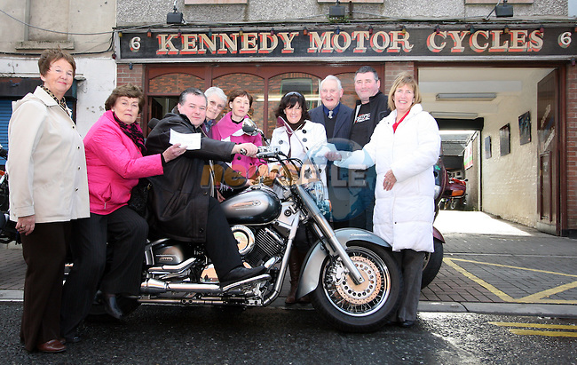 Paul Bell with Linda Bell, James and Jimmy Kennedy of Kennedy Motorcycles as he presents cheques to Ann Tracey and Ann Finnegan of the Gary Kelly Foundation and to Cora Fagan, Carmel Freeman and Sr Therese Kilkenny of Drogheda Hospice Homecare...Photo NEWSFILE/Jenny Matthews.(Photo credit should read Jenny Matthews/NEWSFILE)....This Picture has been sent you under the condtions enclosed by:.Newsfile Ltd..The Studio,.Millmount Abbey,.Drogheda,.Co Meath..Ireland..Tel: +353(0)41-9871240.Fax: +353(0)41-9871260.GSM: +353(0)86-2500958.email: pictures@newsfile.ie.www.newsfile.ie.FTP: 193.120.102.198.
